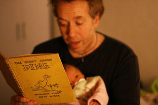 Following a fine family tradition: Reading PING aloud.