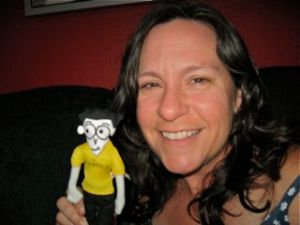 "Deborah with the ""Dummies"" mascot, gifted by the Blue Slip Media folks"