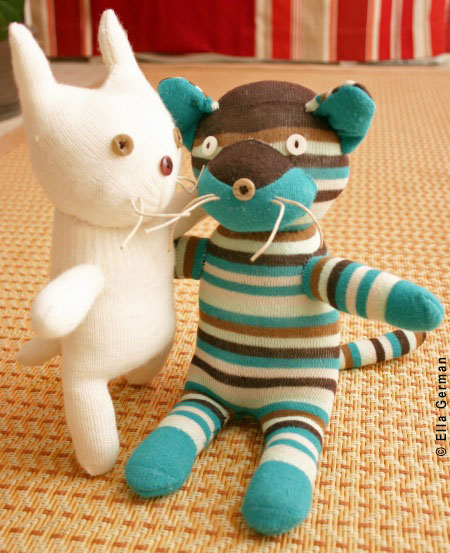 Glove cat and sock cat, created by Ella German