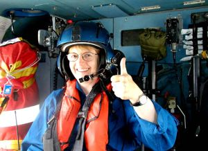 "My editor Emma Dryden on her flight with Air Station Cape Cod.  After an ninety minute flight going from terrified to quietly ecstatic (if that's such a term).  Doffing her flight helmet, she leans into me and exclaims ""No more books about bunnies and ducks!""  She got a chance to experience some of the adventures I've been on."
