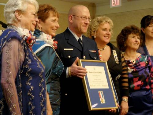 At a special ceremony, Chris was presented with a special Medal of Honor from the DAR for his recent portrait work at the Women's Memorial at Arlington. He's wearing his US Coast Guard Auxiliary uniform.