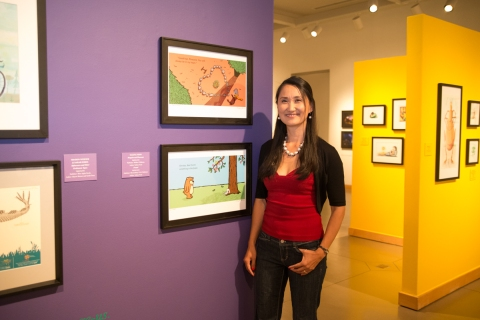 Salina Yoon beside her original work from Penguin and Pinecone and Found!  photo by Roxyanne Young
